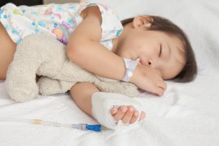 Boy sleeping in hospital patients