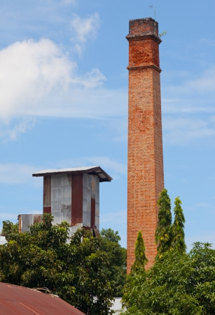 Old brick chimney in rice mills photo