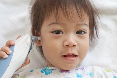 little boy patient sleeping in hospital photo