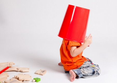 Young boy with a bucket on his head,in Studio shot,rg photo
