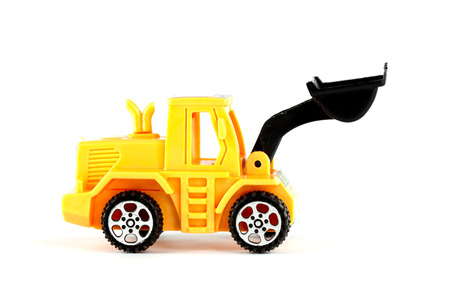 wheel loader toy isolated on white background photo
