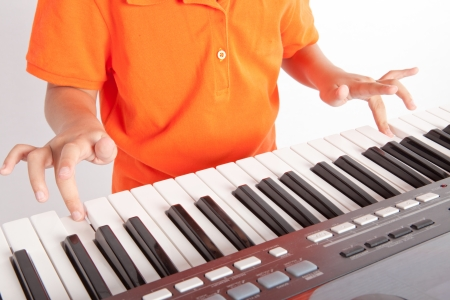 boy and the piano on white background  photo