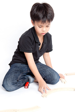 boy building with colorful wooden blocks  Studio shot, Stock Photo