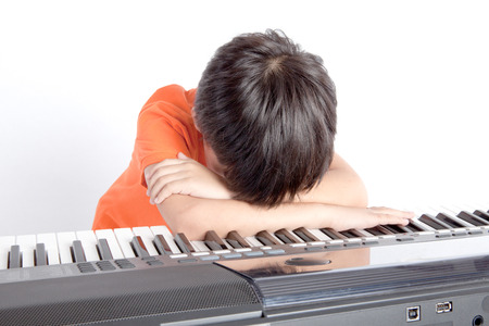 boy and the piano on white background