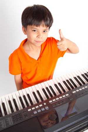 boy and the piano on white background ,studio shot photo