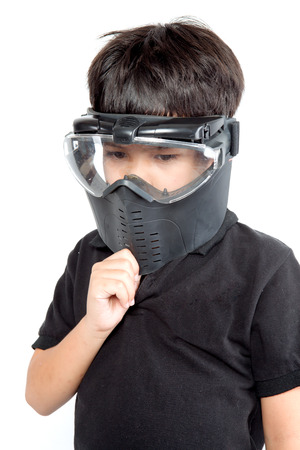A boy wearing a paintball mask Stock Photo