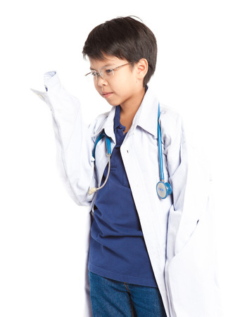Boy wearing doctor with stethoscope.