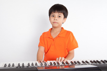 boy and the piano on white background ,studio shot