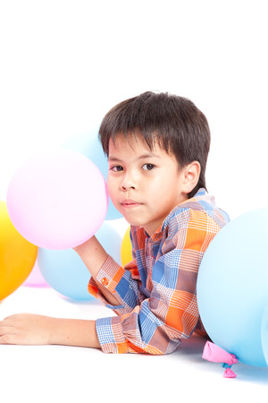boy with balloons isolated on a white background
