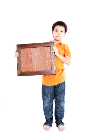 boy holding picture frame a white background. Stock Photo