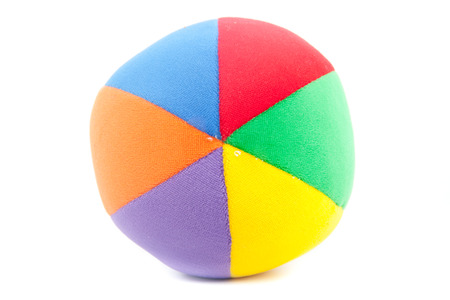 Toy soccer ball made from multicolored patches of cloth photo