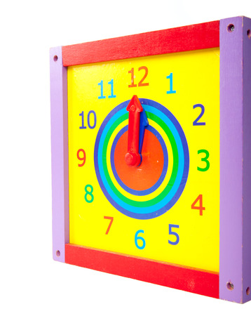 Colorful and round toy clock photo