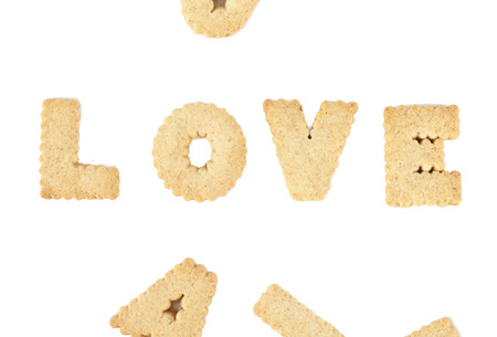 LOVE alphabet chocolate cookies isolated on white background photo