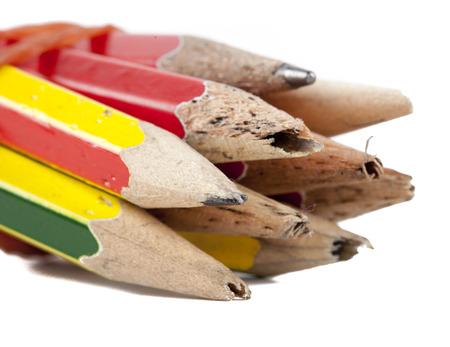 Old pencils isolated on white background photo