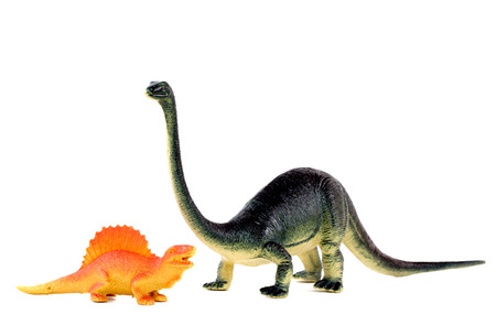 plastic dinosaurs on white background photo