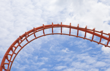 thrill: A segment  roller coaster on blue sky background Stock Photo