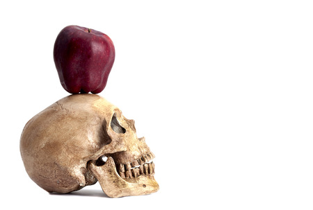 skull and red apple on white background Stock Photo