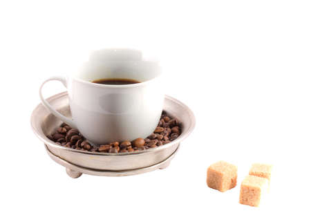 A cup of coffee and sugar photo