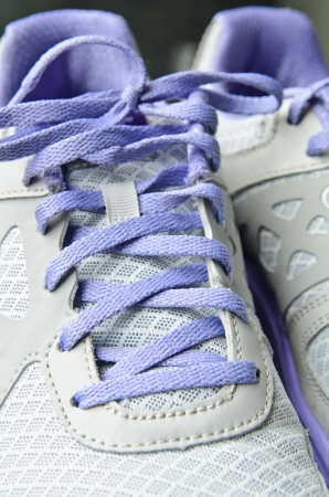 shoestring: Tennis shoes showing close-up shoestring