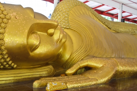 Thai lying buddha statue at a temple