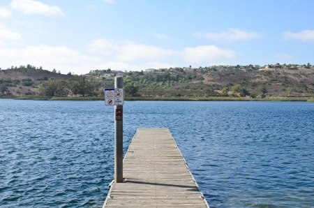 Pier at the lake with signs