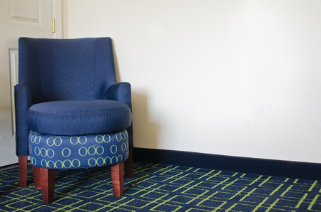 Blue chair in hotel room