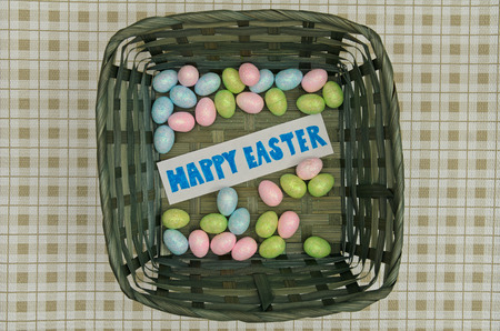 fake smile: Easter eggs in basket with note on table