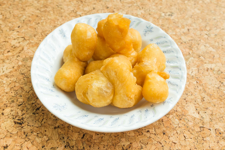patongkoh: Snack and Dessert, Chinese Traditional Snacks Deep Fried Dough Stick on A Plate with cork board