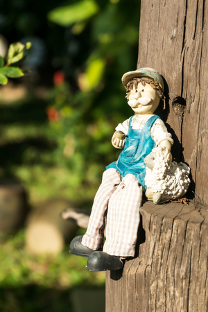resin: A resin Doll on timber, Selective Focus, Blur Background