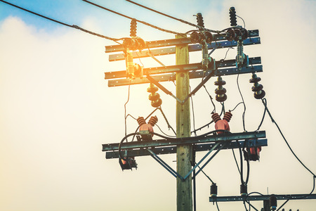 high voltage pole and electric power use on the city. image with sunset and blue sky background Stok Fotoğraf - 91538562