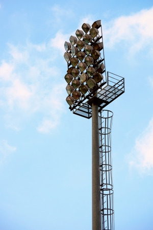 a football stadium light and blue sky photo