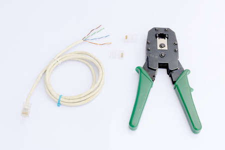 crimping: Crimping tool with connector jack Isolated on white