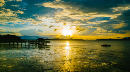 Beautiful sunset at harbor in Ranong, Thailand. Panarama view.
