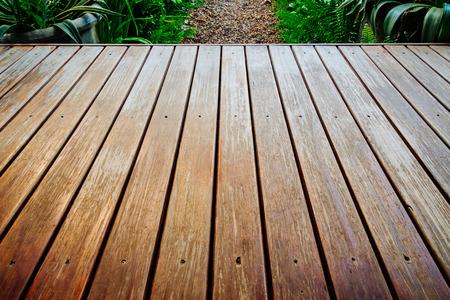 Old wooden deck in garden.