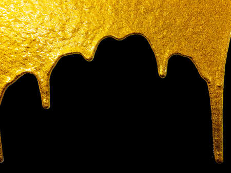 gold paint dripping on black background Imagens