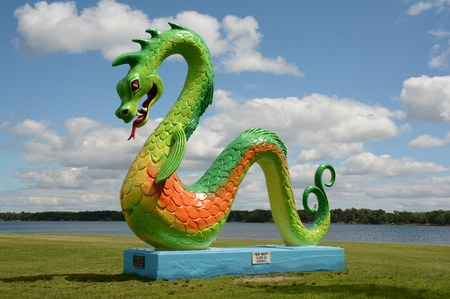 Colorful sea serpent sculpture at Serpent Lake, MN.