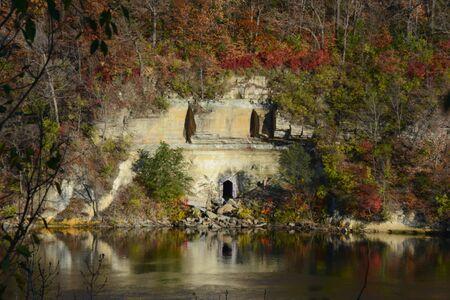 Autumn colors amid rock faces along Mississippi River.