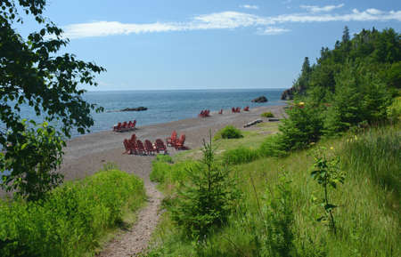 Bright summer vista on scenic Lutsen Resort beachfront, along the north shore of Lake Superior in Minnesota.
