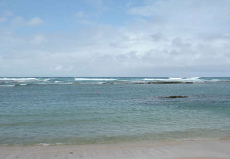 Tranquil winter seascape from Kaihalulu Beach, along the scenic north shore of Oahu Island, Hawaii.