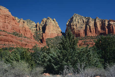 Sunny winter vista on the Ship Rock, an iconic red rock formation in rural Sedona, northern Arizona.