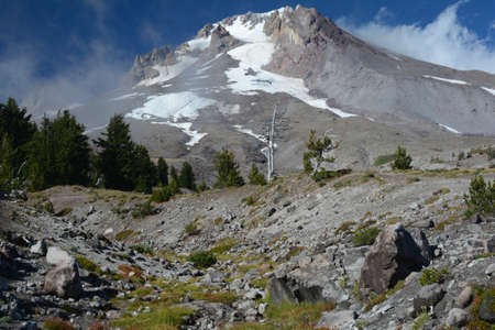 Late summer perspective on majestic Mount Hood and surrounding landscape features.