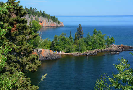 Distant summer vista on the iconic Shovel Point rock formation, from an overlook at Tettegouche State Park on the north shore of Lake Superior in Minnesota.