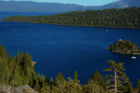 Picturesque historical Vikingsholm overlook on tranquil Emerald Bay and mountain range in background - Lake Tahoe Basin, California.