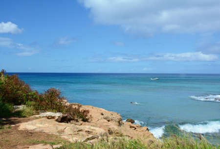 Sunny panoramic overlook on the pacific ocean from Electric Beach, on the scenic west coast of Oahu Island, Hawaii.