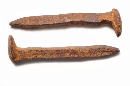 Old rusty railroad spikes isolated Stock Photo