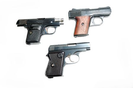 three small semi-automatic pistols isolated Stock Photo