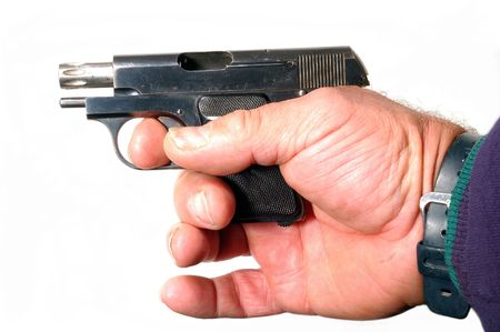 small semi-automatic pistol in hand isolated photo