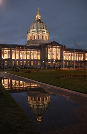 civic: San Francisco Civic Center illuminated at night.with a reflection after a rain