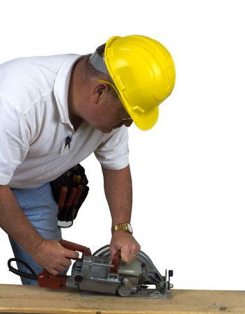 finger on trigger: Carpenter using nail gun to repair box Stock Photo