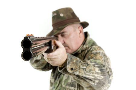 shotgun shooter taking aim over a white background